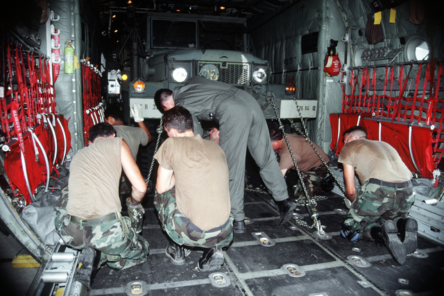 U.S. Army vehicles are secured inside the C-130 aircraft at the Kansas City Downtown Airport. The C-130 Hercules is from the Air Force Reserves 403rd Airlift Wing, 815th Squadron and its C-130s are participating in Exercise Patriot Express '95. The Army personnel will participate in operation Cooperate Nugget after they are airlifted to Fort Polk, La