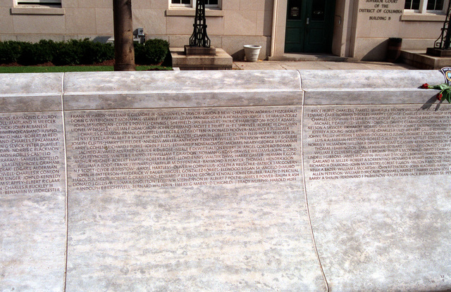 A view of a section of the National Law Enforcement Officer's Memorial located on Judiciary Square. Inscribed upon the wall are the names of all the men and women who, as law enforcement officers, have given their lives in the line of duty