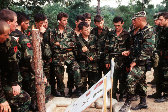 Albanian soldiers are trained in mine detection by STAFF SGT. Donald Ruel (far left), US Army, before participating in a Situational Training Exercise. Soldiers from three NATO and 14 other central and eastern European countries are developing their combined peacekeeping skills during the exercise at the Joint Readiness Training Center. Cooperative Nugget '95 is the sixth Partnership for Peace exercise, but the first to be held on US territory