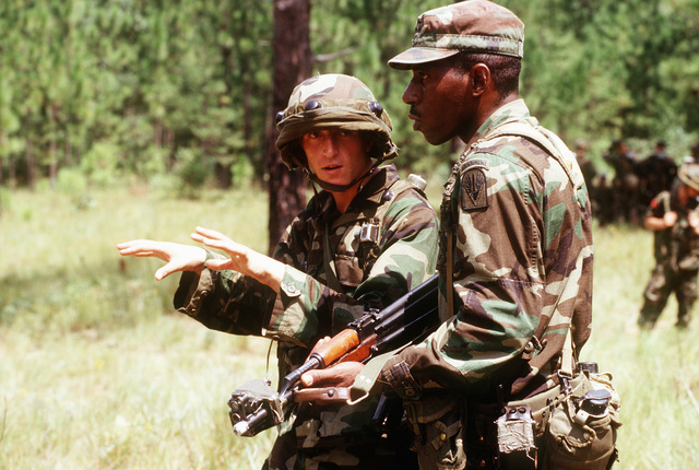 SGT. 1ST Class Anthony Lacour (right), U.S. Army, discusses squad movements with Vladimir Dalipi (left), an Albanian soldier, during the exercise. Soldiers from three NATO and 14 other central and eastern European countries are developing their combined peacekeeping skills during the exercise at the Joint Readiness Training Center. Cooperative Nugget '95 is the sixth Partnership for Peace exercise, but the first to be held on US territory