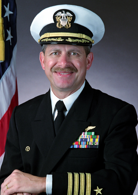Captain Conrad A. Langley, USN (covered)