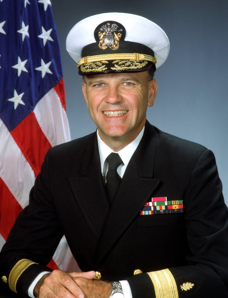 Rear Admiral (lower half) Jerry K. Johnson, USN (covered)