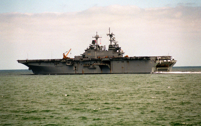A port quarter view of the amphibious assault ship USS WASP (LHD-1) crossing the Trimble Shoals upon returning from sea following the departure of Hurricane Felix from the area