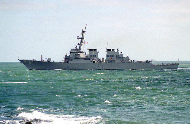 A port side view of the guided missile destroyer USS LABOON (DDG-58) crossing the Trimble Shoals upon returning from sea after departing the area to avoid Hurricane Felix. Note the forward underway replenishment gear in the raised position