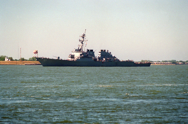 A port side view of the guided missile destroyer USS RAMAGE (DDG-61) passing Fort Monroe upon returning to the roadstead following the passage of Hurricane Felix off to the east