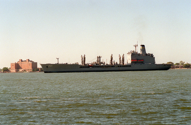 A port side view of the Military Sealift Command fleet oiler USNS PATUXENT (T-AO-201) passing the historic Chamberlain Hotel as the ship returns to the roadstead following the passage of Hurricane Felix from the area