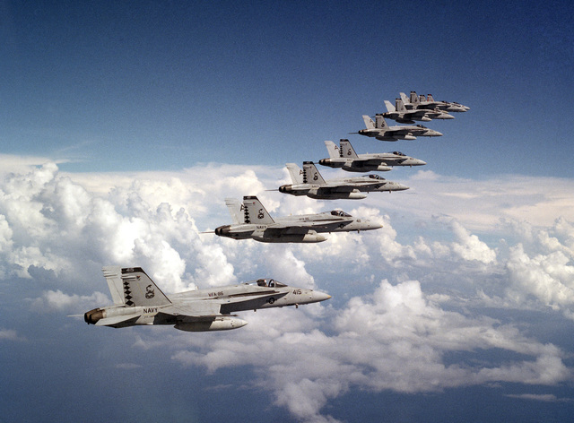 Aerial right side view of ten (10) F/A-18 Hornet aircraft of Strike Fighter Squadron Eighty-Six (VFA-86) flying in formation over the Jacksonville operating area. The squadron is homeported at NAS Cecil Field and is presently assigned to the aircraft carrier USS AMERICA (CV-66) which is about to deploy to the Mediterranean Sea for six months. The formation is being led by CMDR. Russell Ziegler, VFA-86 Commanding Officer