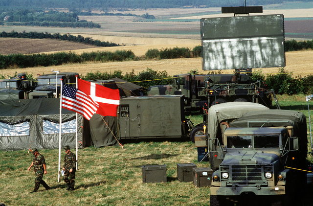 Overhead view of the operational location of the 110th Air Control Squadron, Tennessee Air National Guard. The flags of both the United States and Denmark are shown. Forces from both countries participate in this three week exercise testing the effectiveness of both Danish and American air defenses. Exact Date Shot Unknown