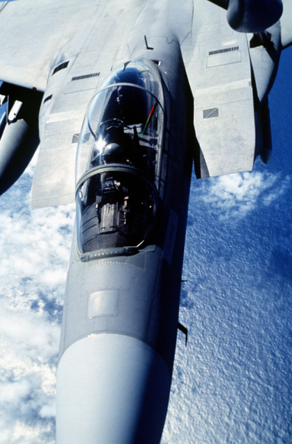 A close up view of a US Air Force F-15 Eagle as it connects to the refueling boom of a KC-135 Stratotanker. The Eagle was part of a joint strike package of US Navy F/A-18 Hornets and US Air Force F-16 Fighting Falcons for the exercise. Joint Task Force 95-3 involved each branch of the armed services and all major units of the US Atlantic Command. The aircraft is from the 69th Fighter Squadron, Moody Air Force Base, Ga.(Exact date unknown)