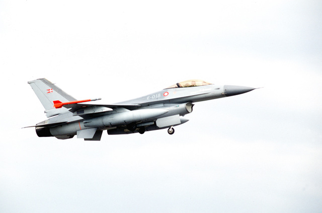 A Danish F-16 takes off. Personnel and aircraft from the 52nd Fighter Wing, Spangdahlem AB, Germany, along with members of the 110th Air Control Squadron, Tennessee Air National Guard participate with Danish forces. The three week exercise tested the effectiveness of both Danish and American air defenses. F-15 and F-16 Fighters from the 22nd and 53rd Fighters Squadrons flew three sorties daily, consisting of air to air and air to ground missions. Exact Date Shot Unknown