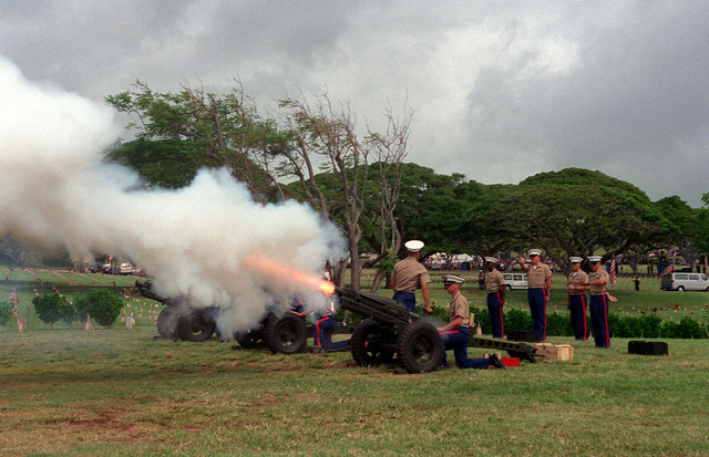 A local Marine Corps unit fires a 21 gun salute at the Punchbowl National Cemetery during the commemoration of the 50th anniversary of the end of World War II