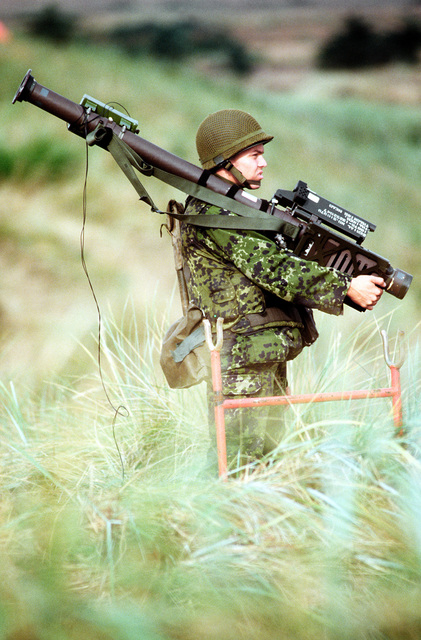 A member of the Danish Army stands and waits for a simulated aerial attack on targets at a Danish bombing range. Danish and American F-16 Fighting Falcons simulate firing and downing of the jets. The three week exercise began 26 Aug 1995 and is designed to test the effectiveness of both Danish and American air defenses. Exact Date Shot Unknown