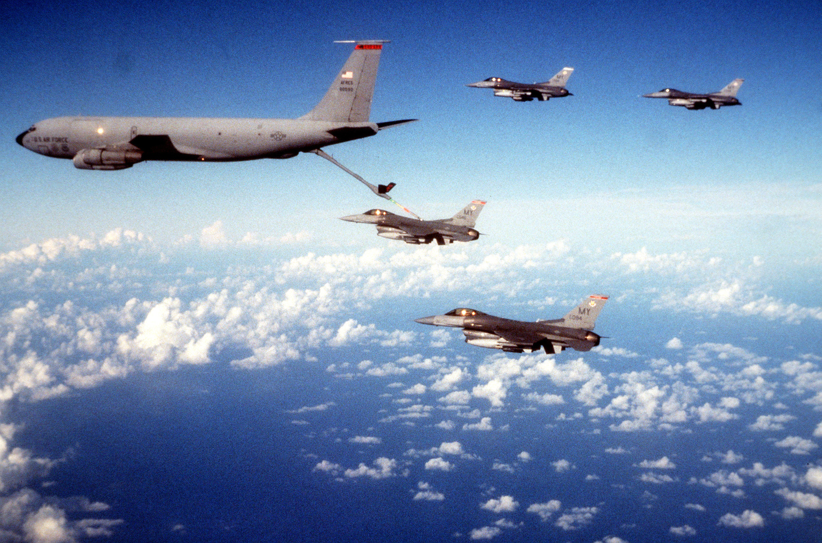 A wide angle view of a US Air Force KC-135 Stratotanker as it refuels a formation of F-16D Fighting Falcons. The Fighting Falcons are part of a joint strike package of US Navy F/A-18 Hornets and US Air Force F-15 Eagles for the exercise. This exercise involved each branch of the armed services and all major units of the US Atlantic Command.(Exact date unknown)
