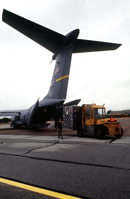 Air Force personnel offload equipment at Flyvestation. Personnel and aircraft from the 52nd Fighter Wing, Spangdahlem AB, Germany, along with members of the 110th Air Control Squadron, Tennessee Air National Guard, deployed to participate with Danish forces. The three week exercise tested the effectiveness of both Danish and American air defenses. F-15 and F-16 Fighters from the 22nd and 53rd Fighters Squadrons flew three air to air and air to ground missions a day. Exact Date Shot Unknown