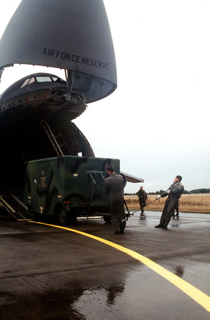 Air Force personnel offload equipment at Flyvestation. Personnel and aircraft from the 52nd Fighter Wing, Spangdahlem AB, Germany, along with members of the 110th Air Control Squadron, Tennessee Air National Guard, deployed to participate with Danish forces. The three week exercise tested the effectiveness of both Danish and American air defenses. F-15 and F-16 Fighters from the 22nd and 53rd Fighters Squadrons flew three sorties daily, consisting of air to air and air to ground missions. Exact Date Shot Unknown