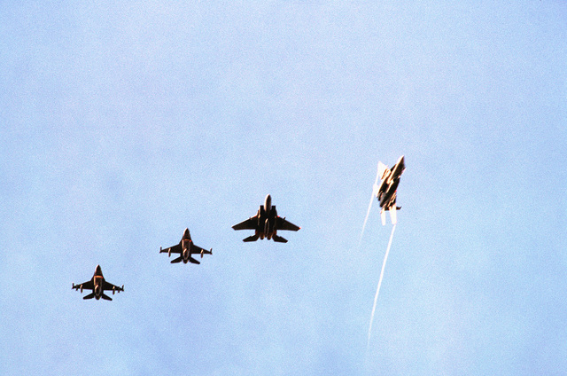 American F-15s and F-16s fly together as they approach the air field. Personnel and aircraft from the 52nd Fighter Wing, Spangdahlem AB, Germany, along with members of the 110th Air Control Squadron, Tennessee Air National Guard participate with Danish forces. The three week exercise began 26 Aug 1995 and tested the effectiveness of both Danish and American air defenses. F-15 and F-16 Fighters from the 22nd and 53rd Fighter Squadrons flew three sorties daily, consisting of air to air and air to ground missions. Exact Date Shot Unknown