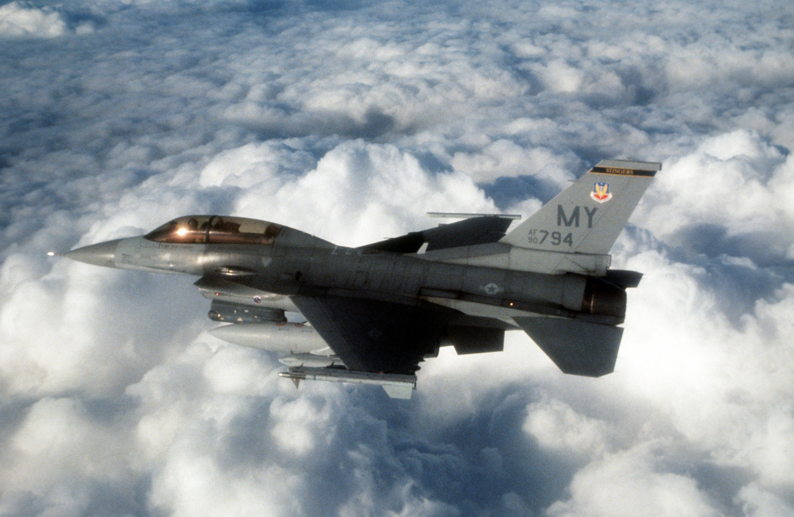 An aerial left side view of a US Air Force F-16 Fighting Falcon from the 69th Fighter Squadron, Moody Air Force Base, Ga., heads for a bombing mission.(Exact date unknown)