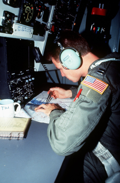 CAPT. Tim Howell, a KC-135 Stratotanker navigator, plots location and flight coordinates to mark warning areas before an aerial refueling mission. The exercise involved each branch of the armed services and all major units of the US Atlantic Command. The aircraft is from the 69th Fighter Squadron, Moody Air Force Base, Ga.(Exact date unknown)