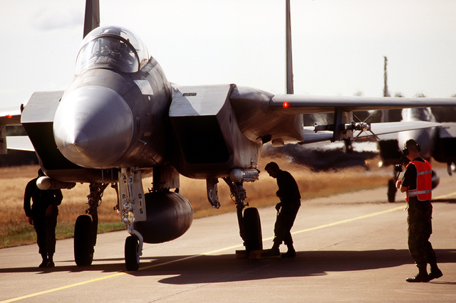 End of Runway crew from the 53rd Fighter Squadron, 53rd Fighter Wing, Spangdahlem AB, Germany, perform post flight inspections of F-15 Strike Eagles returning after completion of air to ground bombing missions. Exact Date Shot Unknown