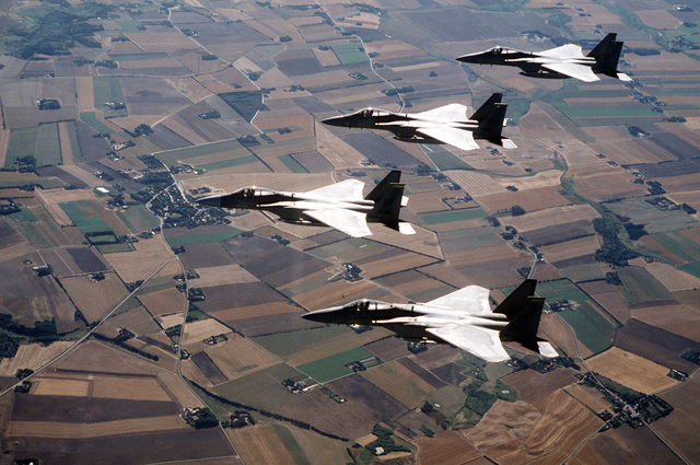 F-15 Strike Eagles from the 53rd Fighter Squadron fly in a finger tip formation over Denmark. The three week exercise began 26 Aug 1995 and is designed to test the effectiveness of both Danish and American air defenses. Exact Date Shot Unknown