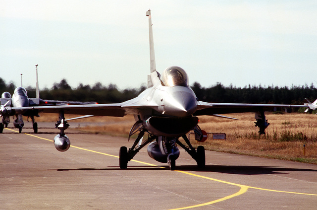 F-16 Falcons from the 52nd Fighter Squadron, 53rd Fighter Wing, Spangdahlem AB, Germany, return after completion of a bombing mission. American forces from the 53rd Fighter Wing are deployed to the Royal Danish Air Force Base. Exact Date Shot Unknown