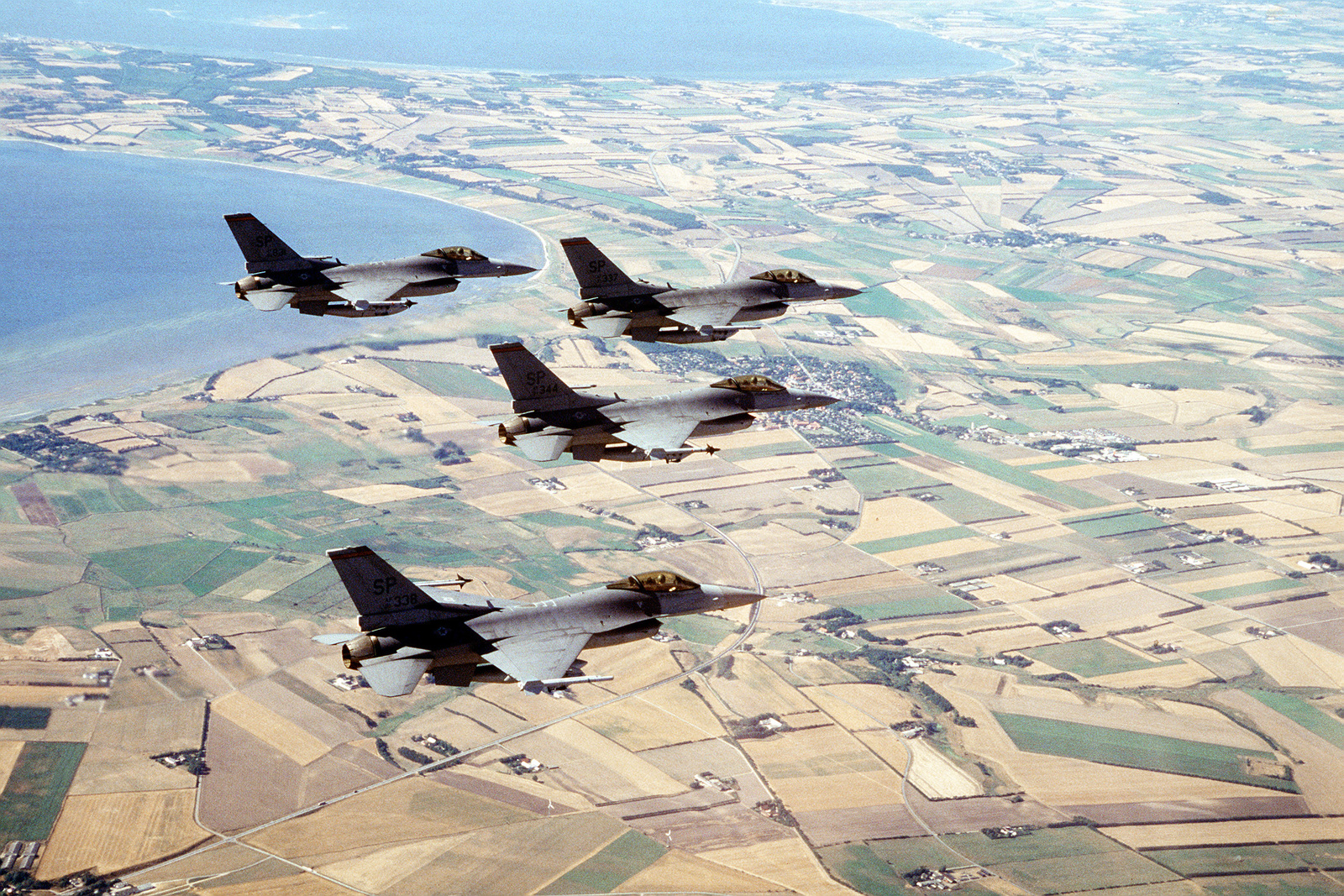 F-16 Fighting Falcons from the 22nd Fighter Squadron fly in a finger tip formation over Denmark. The three week exercise began 26 Aug 1995 and is designed to test the effectiveness of both Danish and American air defenses. Exact Date Shot Unknown