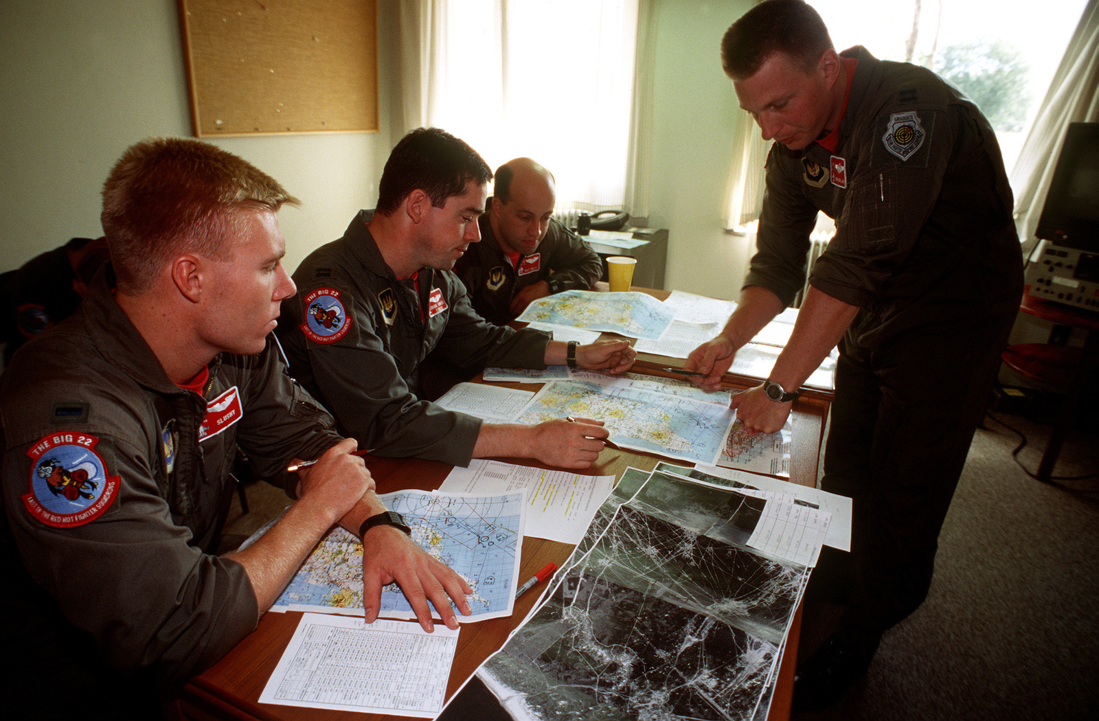 Pilots from the 22nd Fighter Squadron, Spangdahlem AB, Germany conduct a pre-flight briefing before flying a simulated bombing mission over a Danish bombing range. This three week exercise is designed to test the effectiveness of both the American and Danish air defenses. Exact Date Shot Unknown