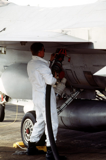 STAFF SGT. Jacob Manning, F-16 Crew CHIEF, 22nd Fighter Squadron, Spangdahlem AB, Germany connects a fuel line to an F-16 Fighting Falcon. The three week exercise began 26 Aug 1995 and tested the effectiveness of both Danish and American air defenses. F-15 and F-16 Fighters from the 22nd and 53rd Fighter Squadrons flew three sorties daily, consisting of air to air and air to ground missions. Exact Date Shot Unknown