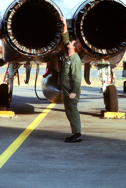 STAFF SGT. Randy Troutman, a member of the 53rd Fighter Squadron, 52nd Fighter Wing, Spangdahlem AB, Germany, performs a basic postflight inspection on the engines of an F-15 Eagle. The three week exercise began 26 Aug 1995 and tested the effectiveness of both Danish and American air defenses. F-15 and F-16 Fighters from the 22nd and 53rd Fighter Squadrons flew three sorties daily, consisting of air to air and air to ground missions. Exact Date Shot Unknown