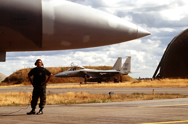 STAFF SGT. Richard Baldez, dedicated Crew CHIEF from the 53rd Fighter Squadron, 53rd Fighter Wing, Spangdahlem AB, Germany, marshals out an F-15 Strike Eagle. American forces from the 53rd Fighter Wing are deployed to the Royal Danish Air Force Base. Exact Date Shot Unknown