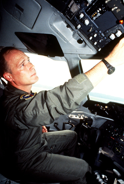 TECH. SGT. Keith Davis, a flight engineer from the 32nd Air Refueling Squadron, does a pre-flight systems check as he prepares for an aerial refueling mission. Joint Task Force 95-3 involved each branch of the armed services and all major units of the US Atlantic Command. The aircraft is from the 69th Fighter Squadron, Moody Air Force Base, Ga.(Exact date unknown)