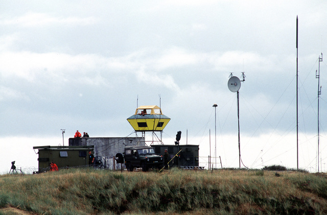 The Range Marshall sits in a tower and keeps an eye on the Danish Bombing range while targets are bombed by American and Danish F-16 Fighting Falcons. The three week exercise began 26 Aug 1995 and is designed to test the effectiveness of both Danish and American air defenses. Exact Date Shot Unknown