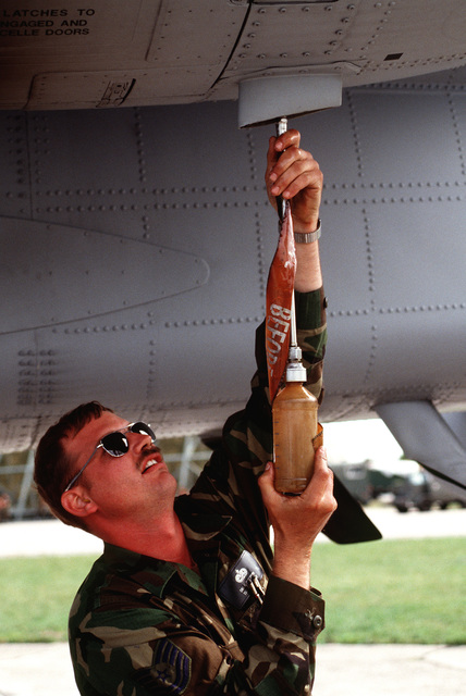 A maintenance technician from the Massachusetts Air National Guard 104th Fighter Group performs preflight checks on a US Air Force A-10 Thunderbolt II at to prepare the aircraft for NATO airstrikes against the Bosnian Serbs