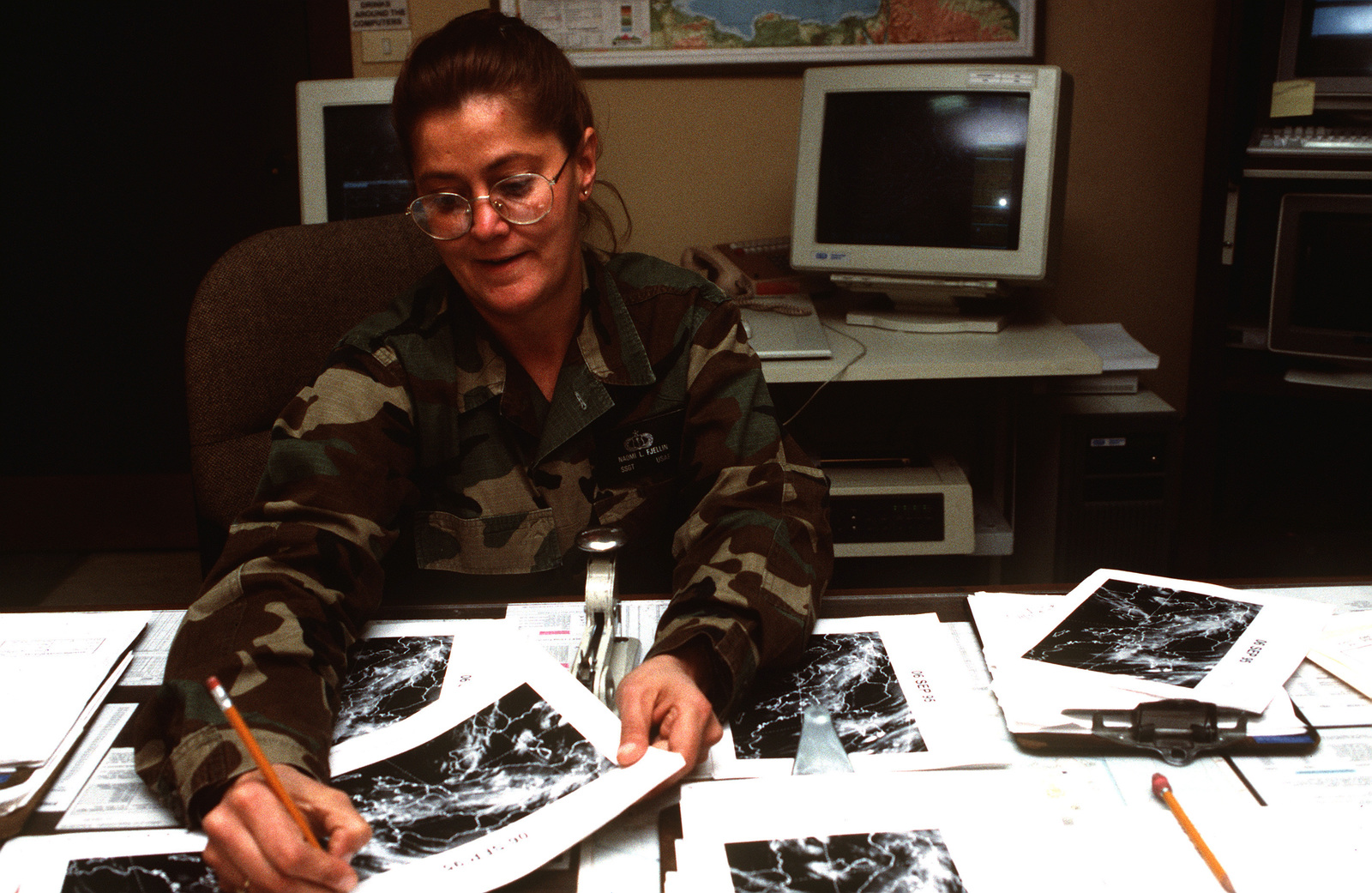 US Air Force STAFF SGT. Fjellin reviews weather conditions over Bosnia for the preparation and support of aircraft involved in NATO airstrikes against the Bosnian Serbs