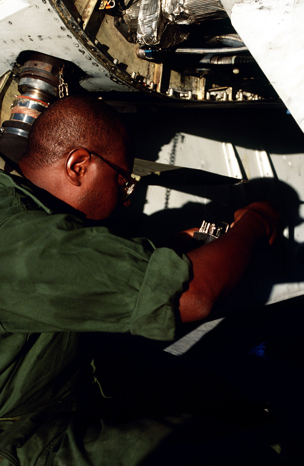 STAFF SGT. Dennard prepares to tack a panel on an EF-111A Raven aircraft on the flightline as the ground crew prepares the aircraft for a NATO airstrike against the Bosnian Serbs. STAFF SGT. Dennard, an aircraft maintenance technician from the 652nd Combat Logistics Support System, McClellan Air Force Base, Calif., is deployed to Aviano to support the 429th Electronics Combat Squadron