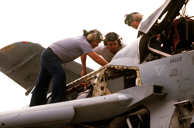 US Navy aircraft maintenance personnel perform a 56 day preventive maintenance inspection on a US Navy EA-6B Prowler on the flightline. The aircraft is from Tactical Electronic Warfare Squadron 141 deployed on board the aircraft carrier USS THEODORE ROOSEVELT (CVN-71). The ROOSEVELT is operating in the Adriatic Sea in support of the operation