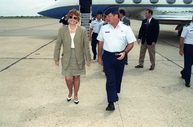 As they walk on the runway, Dr. Sheila Widnall, Secretary of the Air Force, is welcomed by Brig. GEN. Mike Guth, the 27th Fighter Wing commander