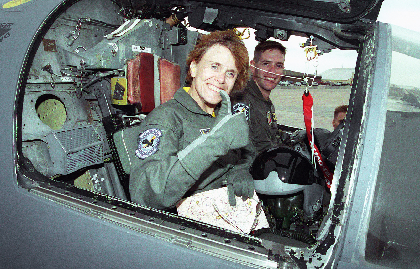CAPT. Mike Pipan, an F-111 pilot, 27th Fighter Wing, 524 Fighter Squadron, and Dr. Sheila Widnall, Secretary of the Air Force, pose in the cockpit for a photo after flying a sortie
