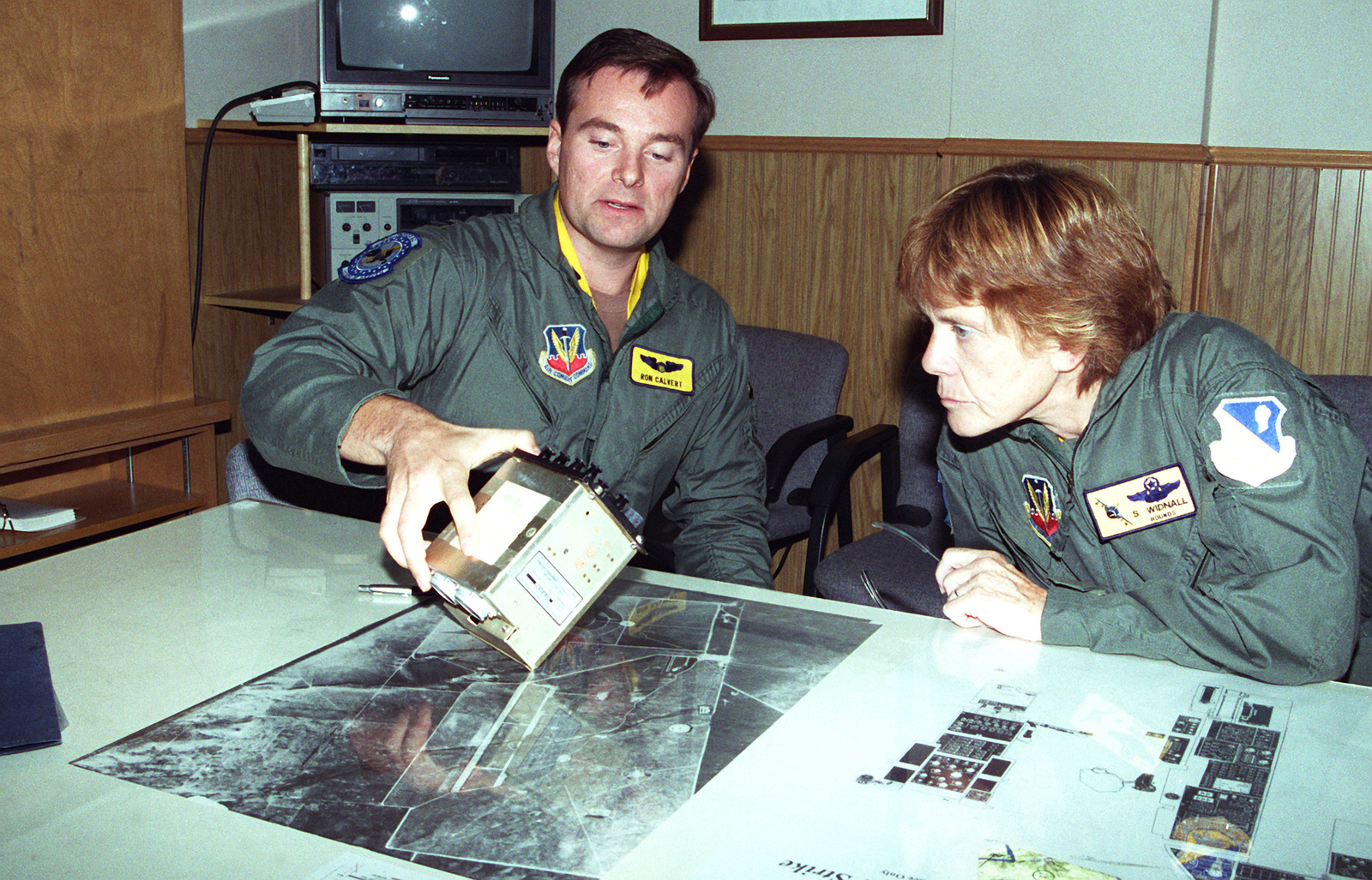 CAPT. Ron Calvert, 27th Fighter Wing, 524th Fighter Squadron, gives Dr. Sheila Widnall, Secretary of the Air Force some preflight instruction before her incentive flight in an F-111