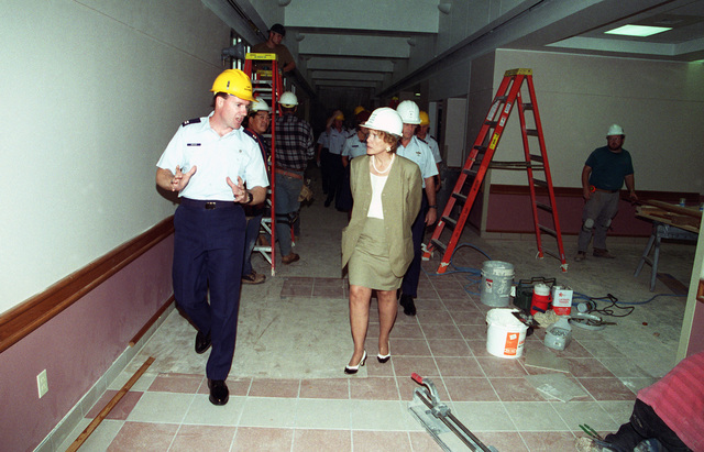 As they work through the construction area in hard hats, CAPT. Wilson Wickiser, 27th Fighter Wing, 27th Medical Group briefs Dr. Sheila Widnall, Secretary of the Air Force, on construction progress at the hospital