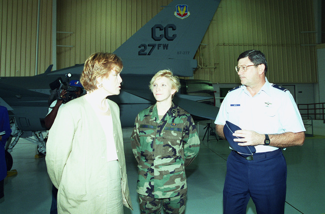 Dr. Sheila Widnall, Secretary of the Air Force, talks with CAPT. Jessica Hamilton, 522nd Fighter Squadron and Brig. GEN. Mike Guth, 27th Fighter Wing commander, on the F-16 and its transition to Cannon Air Force Base