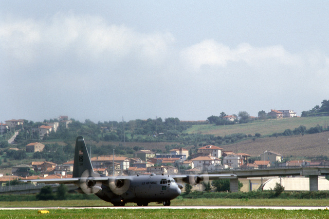 A U.S. Air Force C-130 Hercules rolls for takeoff from Ancona Airport for a relief mission into Sarajevo, Bosnia-Herzegovina. The three-year-old relief effort has been able to resume their relief missions after a five month hold due to aircraft receiving ground fire over Sarajevo. The aircraft is attached to the 37th Airlift Squadron, Ramstein Air Base, Germany