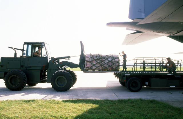 A U.S. Air Force forklift driver moves pallets of sacks of wheat flour in preparation for loading onto a U.S. Air Force C-130 Hercules aircraft which will fly into Sarajevo, Bosnia-Herzegovina on a relief mission. The three-year-old relief effort has been able to resume their relief mission after a five month hold due to aircraft receiving ground fire over Sarajevo. The C-130 crews fly two missions a day into the Sarajevo airport dropping off approximately 30 metric tons of wheat flour to the besieged residents. The personnel are attached to the 37th Airlift Squadron, Ramstein Air Base, Germany