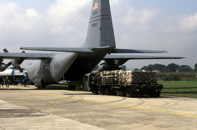 A U.S. Air Force K-loader moves pallets of relief supplies for loading onto a U.S. Air Force C-130 Hercules which will fly the supplies into Sarajevo, Bosnia-Herzegovina. The three-year-old relief effort has been able to resume their relief mission after a five month hold due to aircraft receiving ground fire over Sarajevo. The personnel are attached to the 37th Airlift Squadron, Ramstein Air Base, Germany
