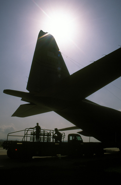 A U.S. Air Force K-loader moves pallets of relief supplies for loading onto a U.S. Air Force C-130 Hercules aircraft which will fly the supplies into Sarajevo, Bosnia-Herzegovina. The Three-year-old relief effort has been able to resume their relief mission after a five month hold due to aircraft receiving ground fire over Sarajevo. The personnel are attached to the 37th Airlift Squadron, Ramstein Air Base, Germany