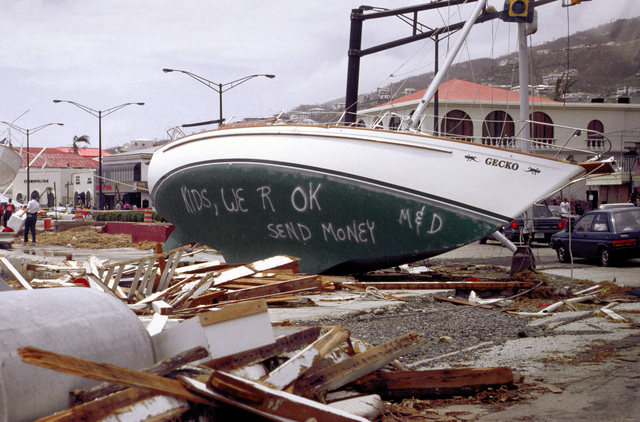 All around the island of St Thomas, survivors of Hurricane Marilyn left messages wherever they could in hopes that relatives might see them on television and newspaper coverage since telephone lines were down. This message, on a boat that ended up against a traffic signal, was written by John and Bonnie Honer of Pensacola, Fla., to their children