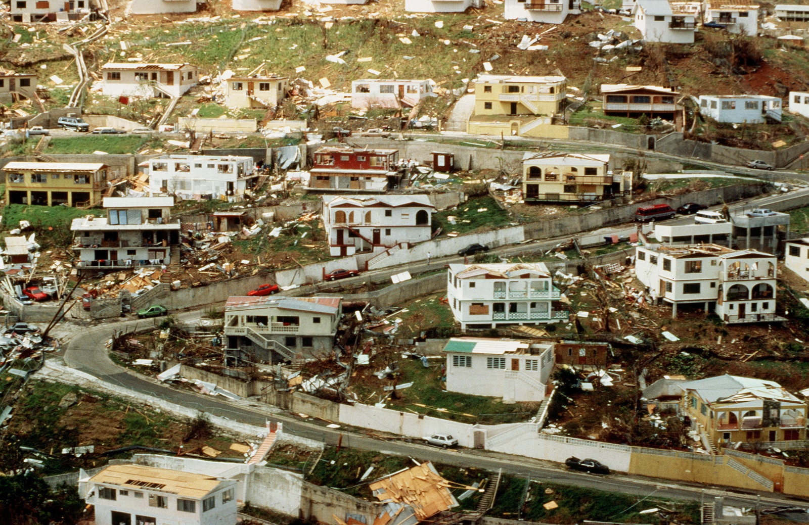 The debris and devastation scattered across St. Thomas from Hurricane Marilyn is visible in this photograph. The U.S. Air Force is flying in personnel and relief supplies for victims of Hurricane Marilyn