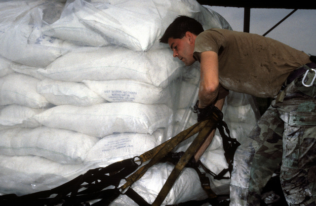 U.S. Air Force personnel with the 37th Airlift Squadron, Ramstein Air Base, Germany, prepare pallets of sacks of wheat flour in preparation for loading onto a U.S. Air Force C-130 Hercules aircraft which will fly into Sarajevo, Bosnia-Herzegovina on a relief mission. The three-year-old relief effort has been able to resume their relief missions after a five month hold due to aircraft receiving ground fire over Sarajevo. The C-130 crews fly two missions a day into the Sarajevo airport dropping off approximately 30 metric tons of wheat flour to the besieged residents.PHOTO by TECH. SGT. Bruce Sherwood