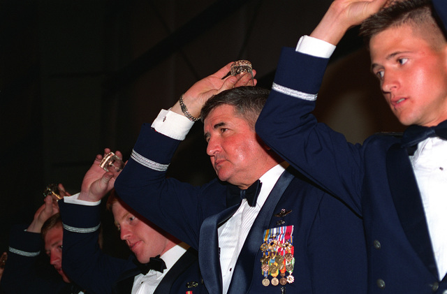 "GEN. Ronald Fogelman, Air Force CHIEF of STAFF, is joined by Air Force Academy Cadets at the ""Grog"" bowl during the 355th Wing ""Wing Ding"" held in GEN. Fogelman's honor"