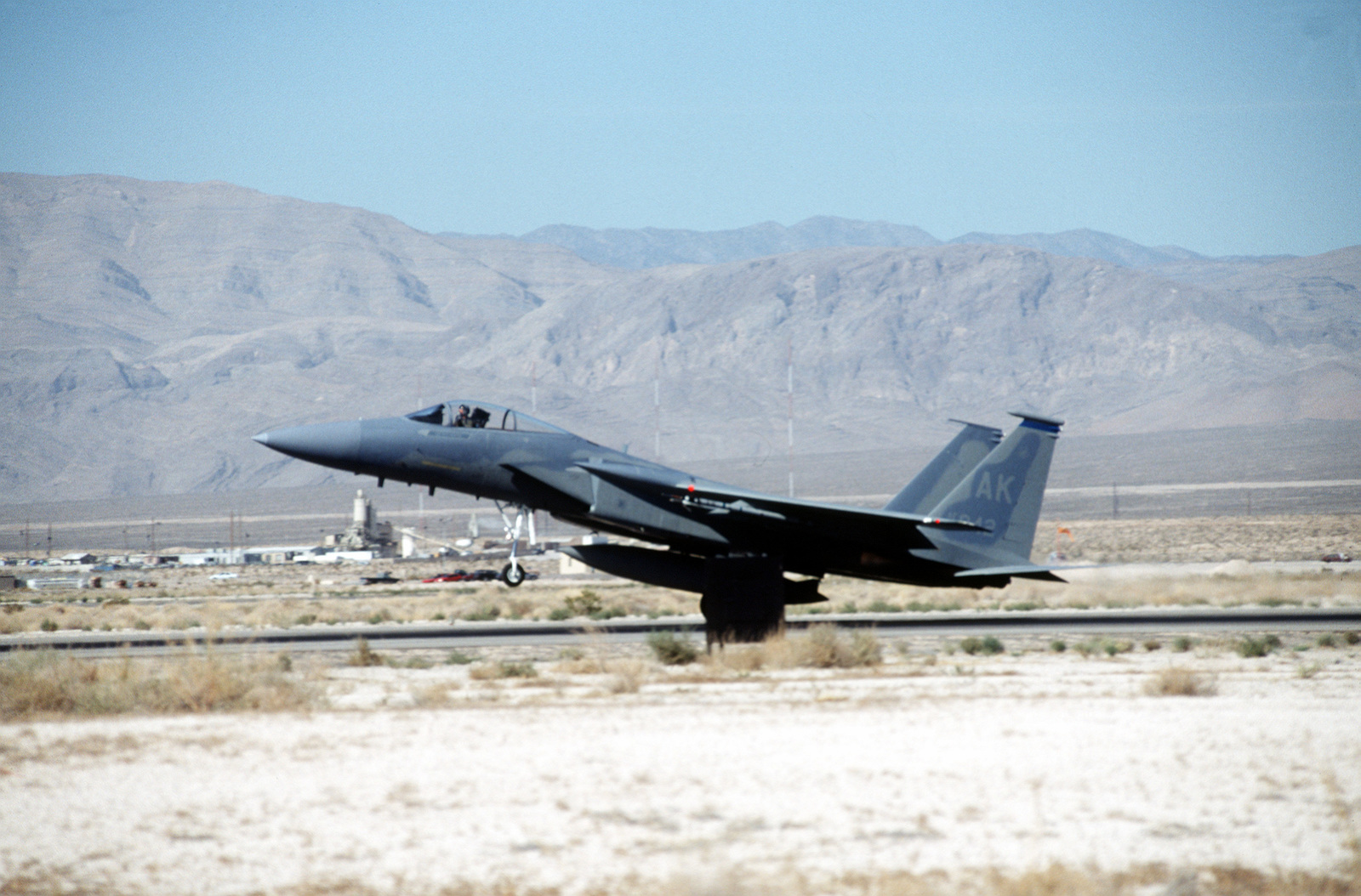 An F-15C Eagle from 3rd Wing, Elmendorf Air Force Base, Alaska takes off from the Nevada base during GUNSMOKE 95. Exact Date Shot Unknown
